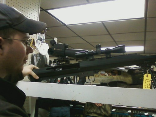 Hubby with 50 cal gun