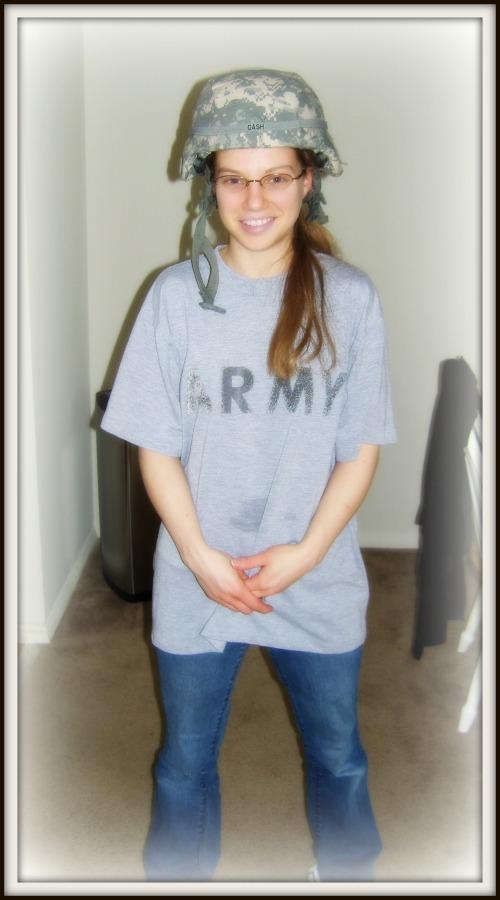 Priscilla wearing army helmet